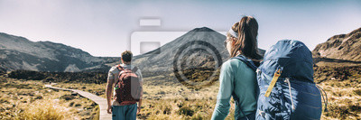 Fototapeta New Zealand Hiking Couple Backpackers Tramping At Tongariro National Park. Male and female hikers hiking by Mount Ngauruhoe. People living healthy active lifestyle outdoors