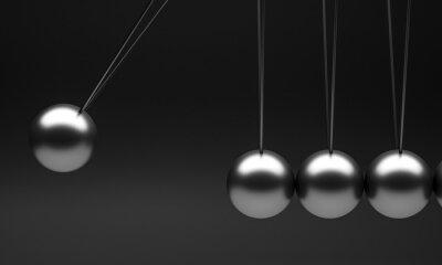 newton pendulum cradle on a black background.