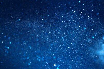Fototapeta niebieskie tło wzór światła świecidełka. nieostre