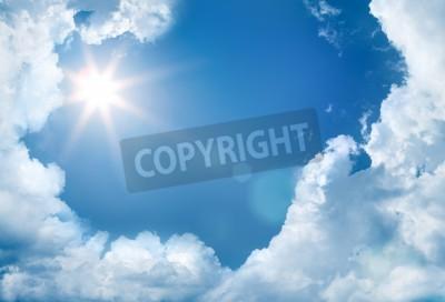 Fototapeta niebo z chmurami i słońcem