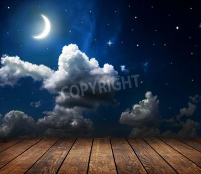 Fototapeta Nocne niebo z gwiazdami i księżyc i chmury