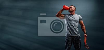 Fototapeta Nutritional Supplement. Muscular Men Drinks Protein, Energy Drink After Workout