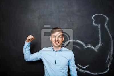 Obraz zabawny człowiek z mięśni ramienia fałszywe