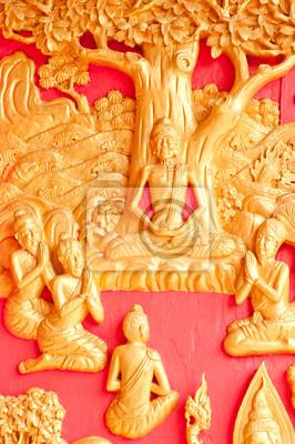 Obrazy Buddy są wyryte na ścianie świątyni