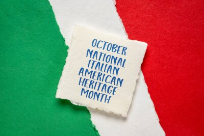 Fototapeta October - National Italian American Heritage Month, handwriting on handmade paper against abstract in colors of national flag of Italy (green, white and red), reminder of cultural event