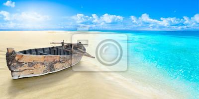 Fototapeta Old fishing boat on the seashore. Sandy beach.