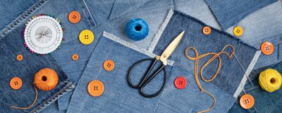 Fototapeta Old jeans upcycling idea. Crafting with denim, recycling old clothers, hobby, diy activity