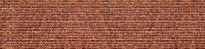 Fototapeta Old red brick wall background, wide panorama of masonry