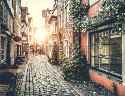 Fototapeta Old town in Europe at sunset with retro vintage Instagram style filter effect