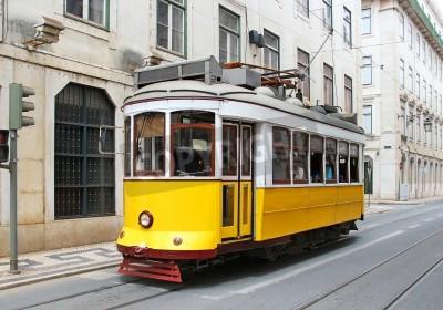 Fototapeta Old yellow tram in Lisbon downtown, Portugal