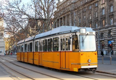 Fototapeta Orange tram on the street of Budapest, Hungary