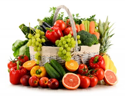 Fototapeta Organic vegetables and fruits in wicker basket isolated on white