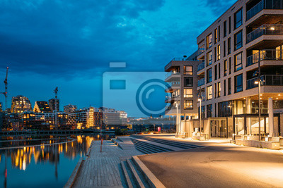 Fototapeta Oslo, Norway. Night View Embankment And Residential Multi-storey House On Sorengkaia Street In Gamle Oslo District. Residential Area In Summer Evening