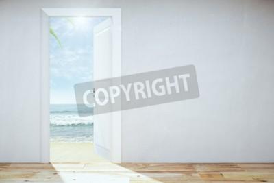 Fototapeta Otworzył drzwi do nieba z plaży i widokiem na morze