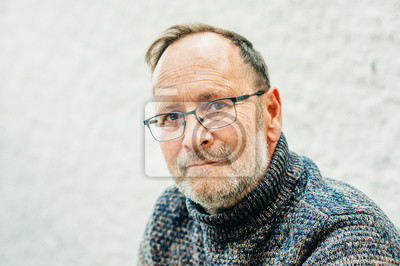 Fototapeta Outdoor portrait of 50 year old man wearing brown pullover and eyeglasses