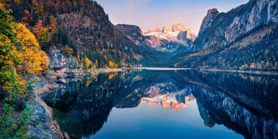 Fototapeta Panoramic autumn view of Gosausee (Vorderer) lake with Dachstein glacieron background. Stunning sunset scene of Austrian Alps, Upper Austria, Europe. Beauty of nature concept background..