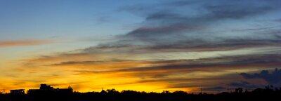 Panoramic beautiful sunset sky with clouds