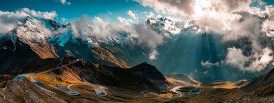 Fototapeta Panoramic Image of Grossglockner Alpine Road. Curvy Winding Road in Alps.