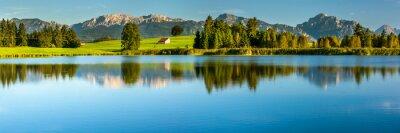 Fototapeta panoramic landscape with alps mountain range at springtime