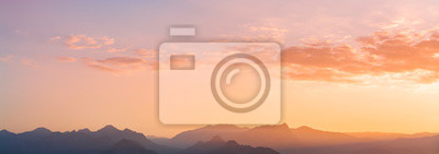 Panoramic mountains view. Beutiful sky and clouds after sunset.  Landscape background.