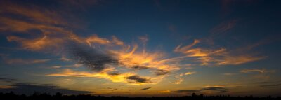 Panoramic of breathtaking sunset, beautifull sky clouds background