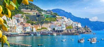Fototapeta Panoramic view of beautiful Amalfi on hills leading down to coast, Campania, Italy. Amalfi coast is most popular travel and holiday destination in Europe.