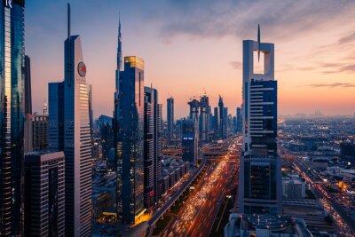 Fototapeta Panoramic View Of Illuminated City Buildings Against Sky During Sunset