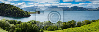 Fototapeta panoramic view of kentallen bay with loch linnhe and the ardnamurchan peninsula in the argyll region of the highlands of scotland on a blue spring day