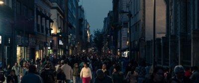 Fototapeta Panoramic View Of People In City At Night