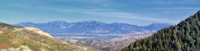 Fototapeta Panoramic view of Wasatch Front Rocky Mountains from the Oquirrh Mountains with fall leaves, by Kennecott Rio Tinto Copper mine, Utah Lake and Great Salt Lake Valley. Utah, America.