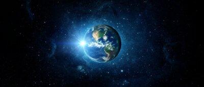 Fototapeta Panoramiczny widok Ziemi, słońca, gwiazdy i galaktyki. Wschód słońca nad planetą Ziemia, widok z kosmosu. Elementy tego zdjęcia dostarczone przez NASA