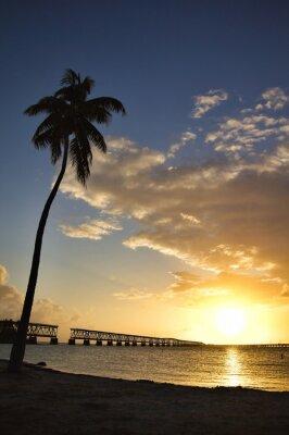 Fototapeta Park stanowy Bahia Honda i most kolejowy o zachodzie słońca.