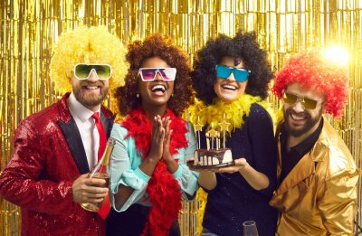 Fototapeta Party event and friendship. Young funny smiling laughing friends in disco fashion wear standing with birthday cake and champagne having fun, celebrating, congratulating and wishing good