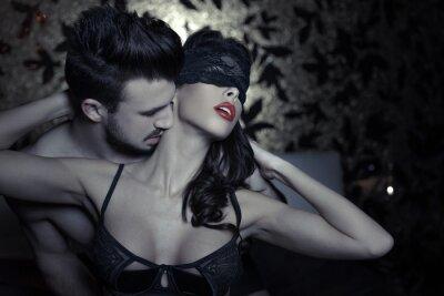Fototapeta Passionate couple foreplay at night