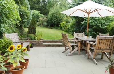 Fototapeta Patio with garden furniture and parasol