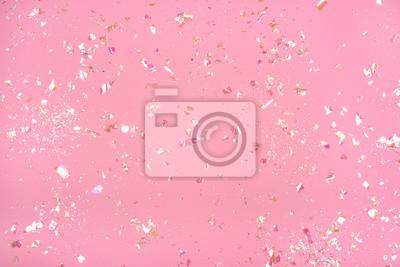 Fototapeta Pearl confetti on pink background.