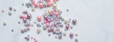 Fototapeta Pearls background. Pearls on marble background. Fashion and luxury jewelry concept