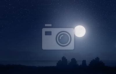 Fototapeta Pełnia księżyca nad miastem