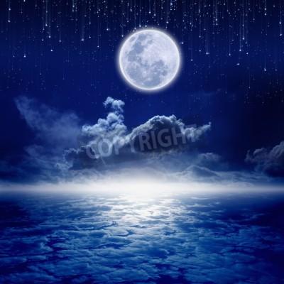 Fototapeta Pełnia księżyca w nocnym niebie z spadających gwiazd i tajemniczego jaskrawy horyzoncie. Elementy tego zdjęcia dostarczone przez NASA http://visibleearth.nasa.gov