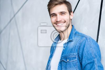 Fototapeta Perfect man. Portrait of happy fashionable handsome man in jeans shirt.