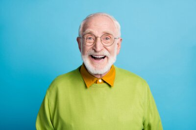 Fototapeta Photo of retired old man open mouth shiny smile excited wear glasses green pullover isolated blue color background