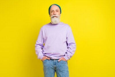 Fototapeta Photo portrait of aged man confident serious wearing trendy outfit headwear isolated bright yellow color background