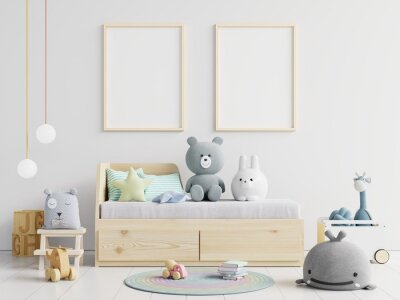 Fototapeta Picture Frames Hanging On Wall Over Toys At Home