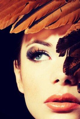 Fototapeta Piękna kobieta z brązowym profesjonalnego makijażu