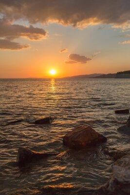 Fototapeta piękny zachód słońca w południe