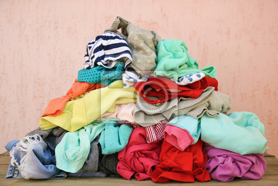 Fototapeta Pile of carelessly scattered clothes.