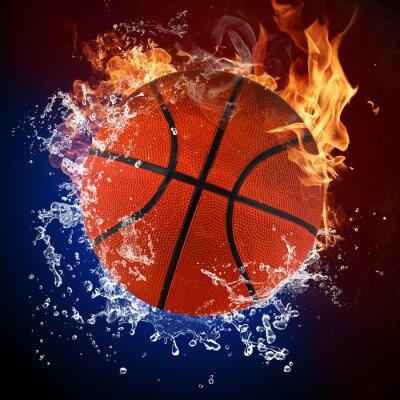Fototapeta Piłka do koszykówki w płomieniach ognia i zalewaniem