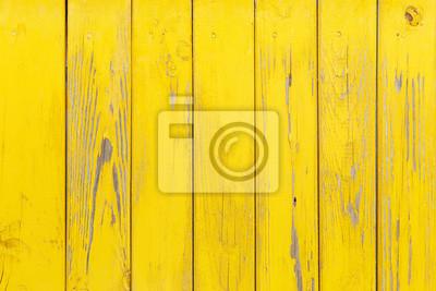 Fototapeta Pionowe tła z drewnianych desek z krakingu farby żółtej