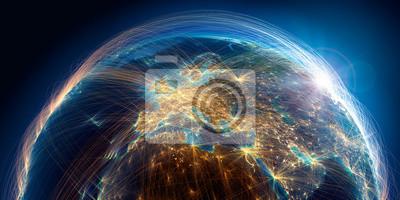 Fototapeta Planeta Ziemia ze szczegółową ulgą jest pokryta złożoną siecią świetlną tras lotniczych w oparciu o rzeczywiste dane. Europa. Renderowania 3D. Elementy tego obrazu dostarczone przez NASA