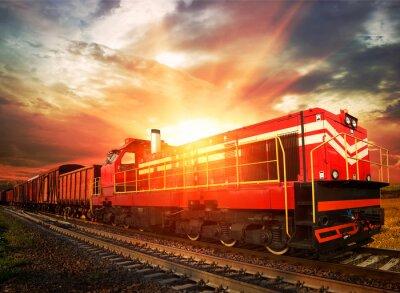 Fototapeta Pociąg towarowy w porannym słońcu